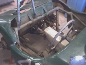 """Rear canvas """"firewall"""" removed exposing the ladder frame, roll bar, gas tank. Let me ask you: Trust that roll bar?"""